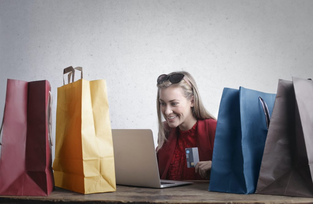 Happy woman shopping at home